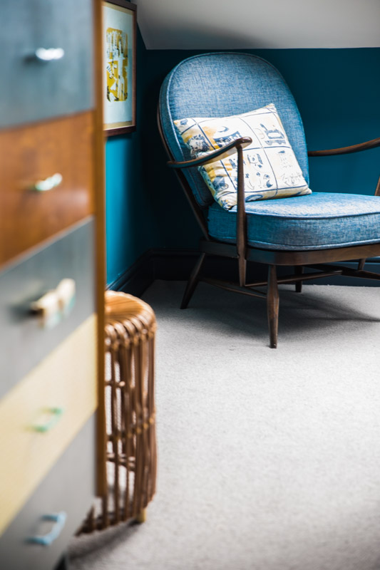 Retro chairs and drawers in Turquoise bedroom