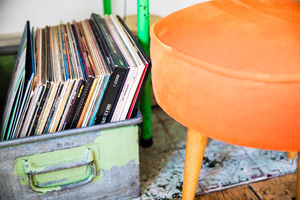 Orange velvet stool and industrial accessories