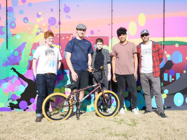 Arkansas Arts Academy students and their teacher, David Kersey, in front of the mural they designed for the Rogers BMX/skate park.