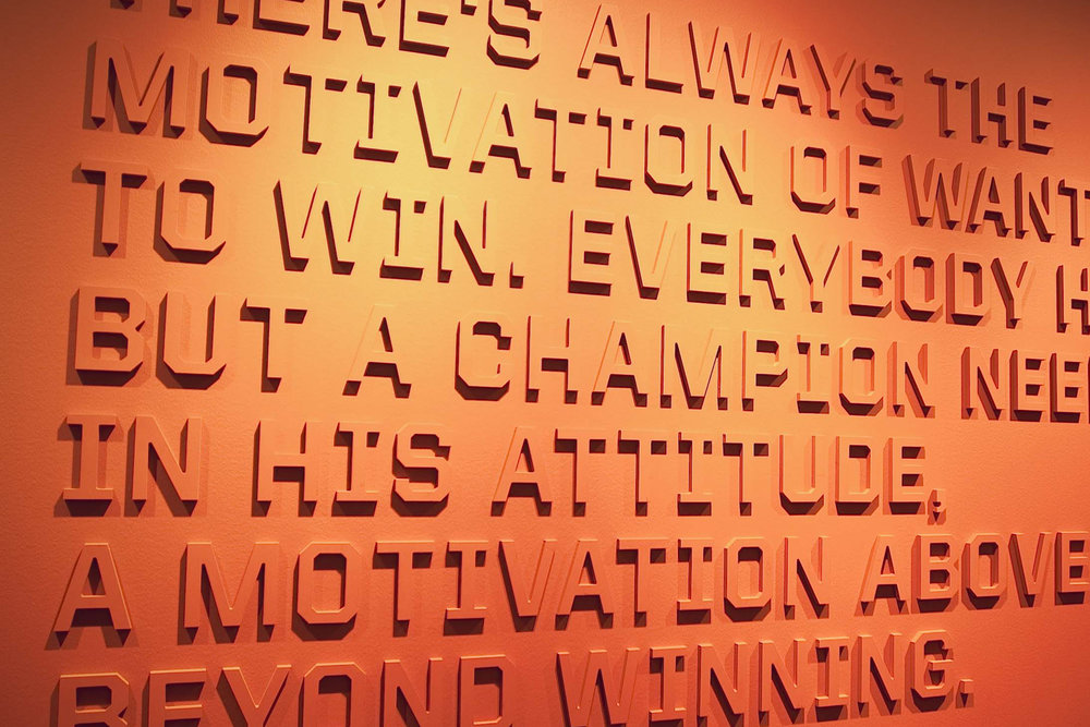 "Metro Signs fabricated raised lettering for the Miami Heat ""Championship Alley"" wall at the American Airlines Arena."