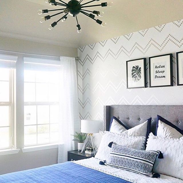 We are in 😍 with this room reveal by @homestoriesbyish — simply beautiful! Thanks for sharing! #Repeelwallpaper print is Chevron Woodgrain in Metallic Silver. #peelandstick #roomreveal #diy #bedroom #bedroomdecor