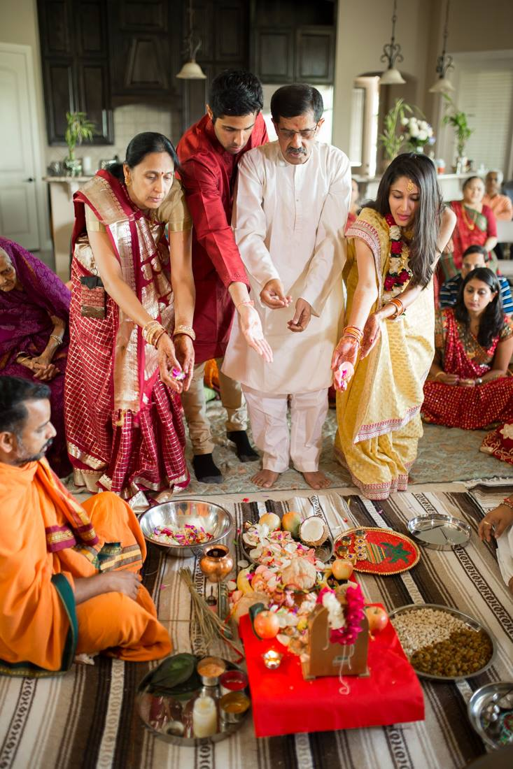 The bride's family offering fruits and flowers.
