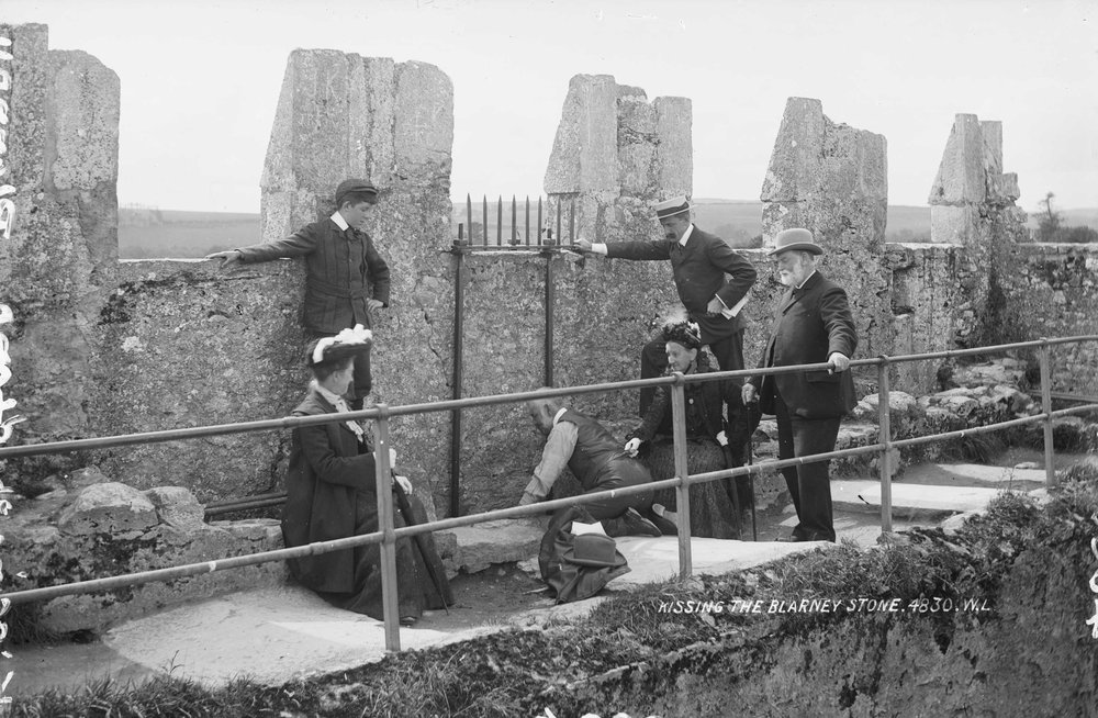 Kissing_the_Blarney_Stone_1897.jpg
