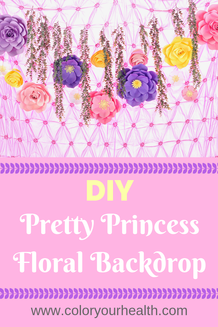Princess party DIY backdrop inspiration: colorful paper flowers add so much elegance to this simple party decor! Would look amazing behind the dessert table!