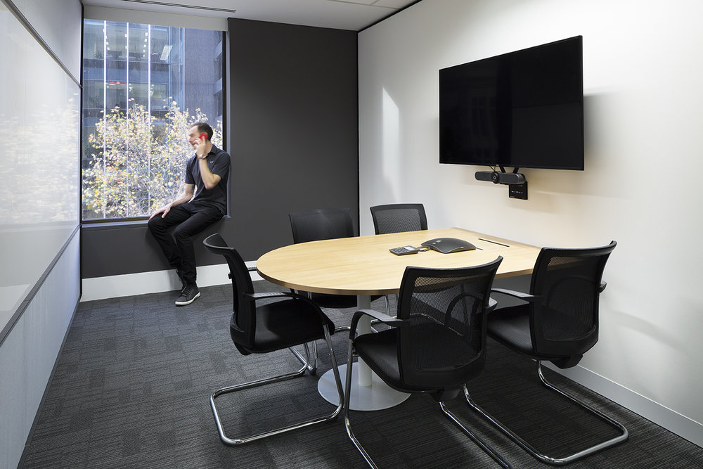 A meeting room at BNY Mellon featuring advanced video conferencing facilities.