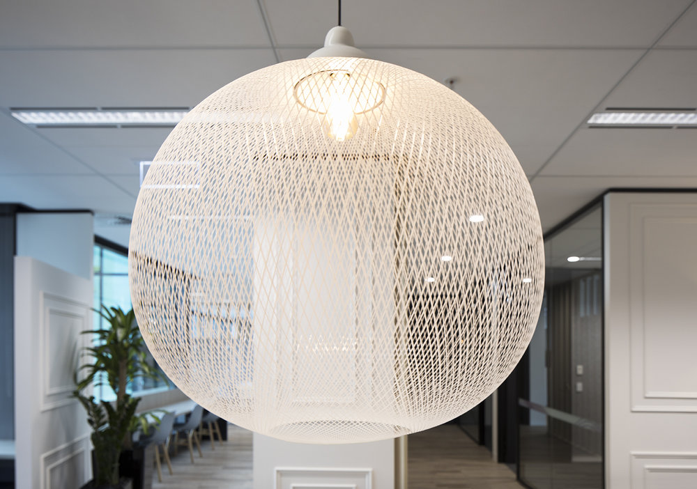 An intricate light is the centerpiece of this fitout.
