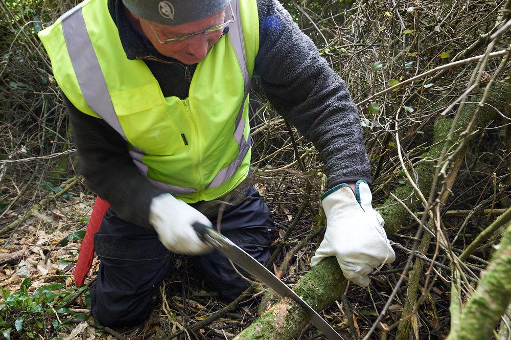 Volunteer maintaining tracks