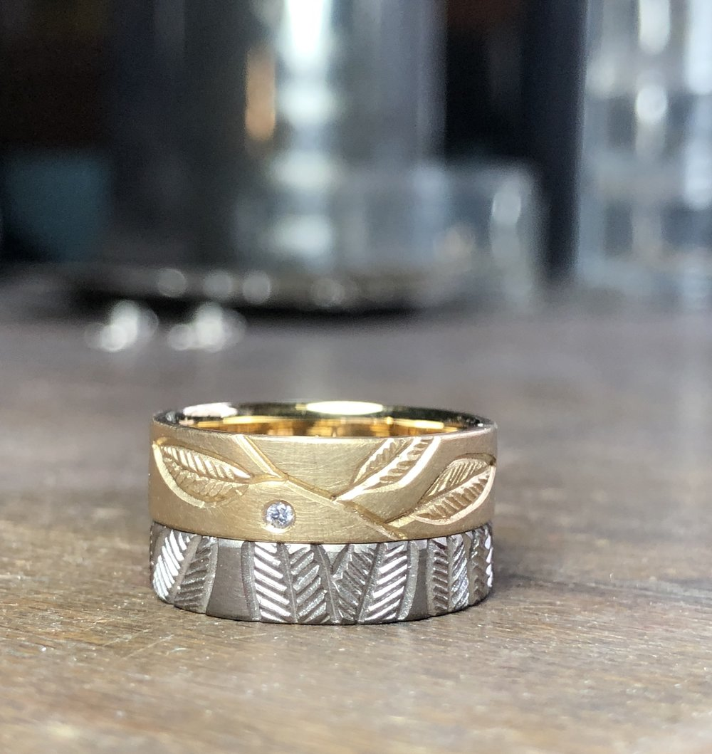 18ct yellow gold band with leaf engraving and 1.5mm white diamond Fsi1. width 5.3mm, thickness 1.4mm, size M. $1380  18ct white gold band with leaves all around the band. width 4.2mm, thickness 1.4mm, size L1/2. $1150