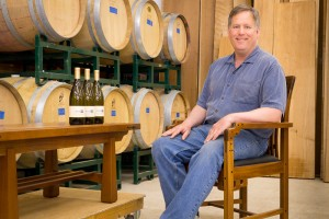 Image of Tom Stangeland sitting in his barrel room at Cloudlift Cellars.