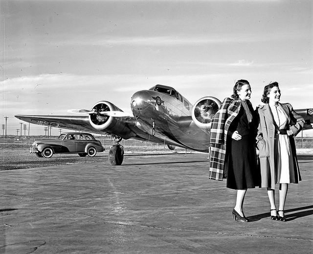 Two people in front of an airplane, ca. 1940s