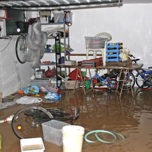 Flooded room in house with belongings all wet