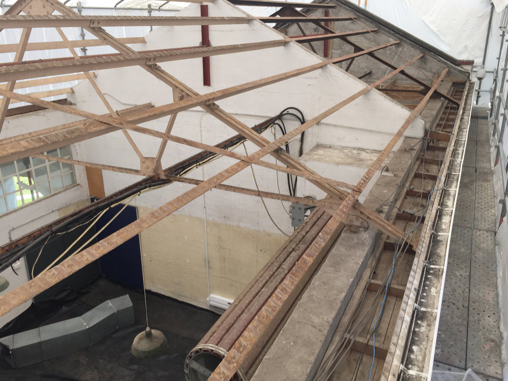 Bare roof construction after asbestos roof removal