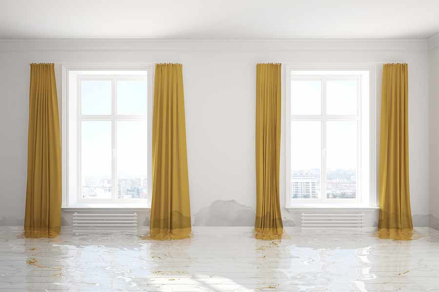 Wet room and yellow curtains after flash flood