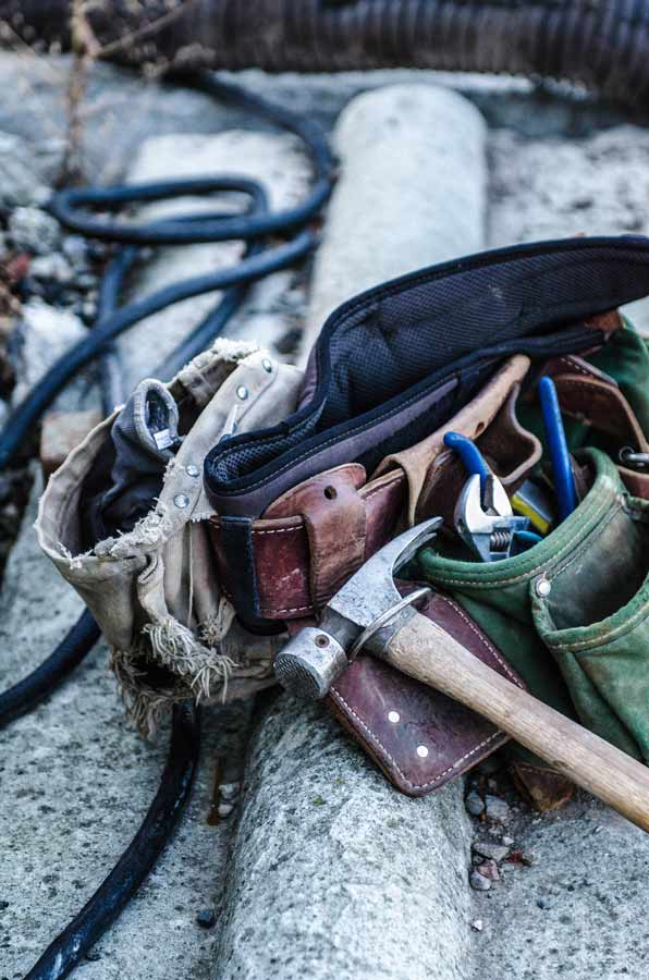 A collection of building tools used to renovate a property with asbestos