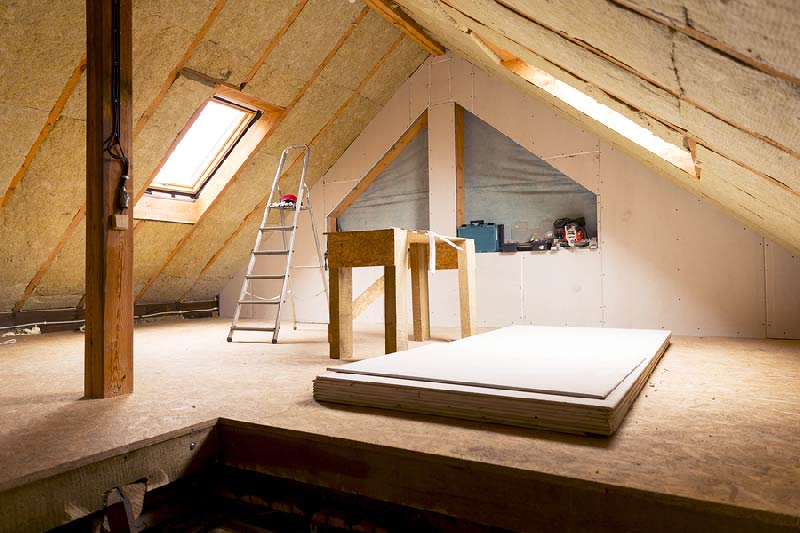 An attic with lots of asbestos insulation