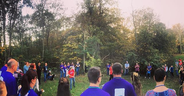 Beautiful moment of solemnity during the tree planting ceremony at the Out of the Darkness Walk for Suicide Prevention in Shepherdstown.