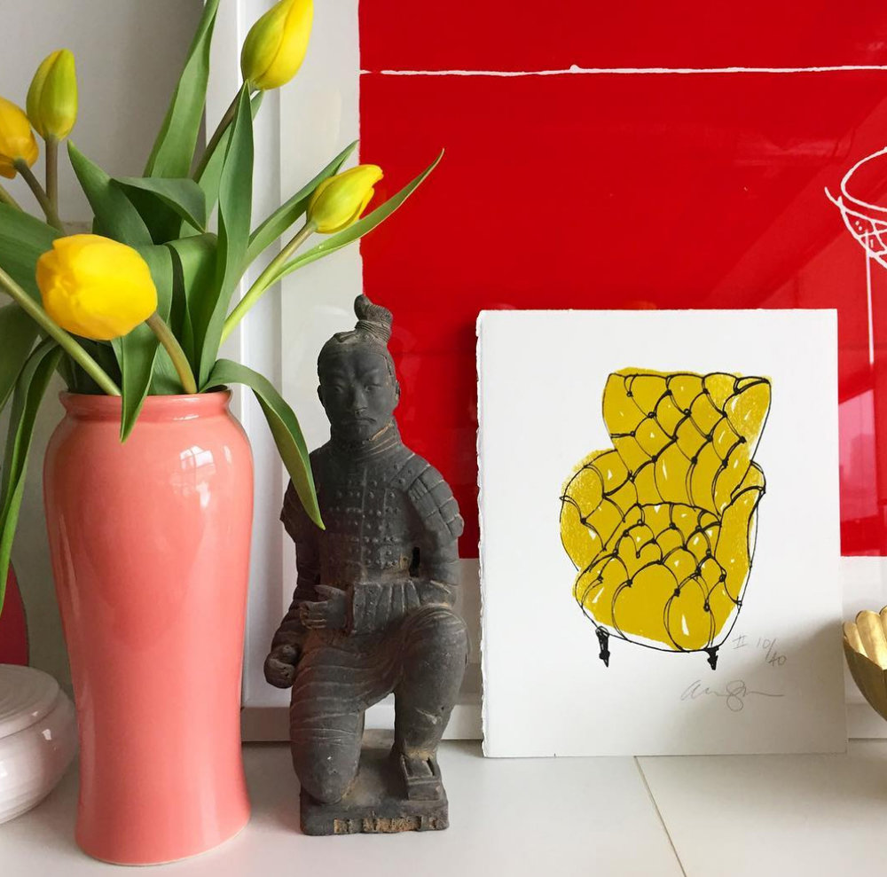 My lime slipper chair print with some juicy yellow tulips and big red teapot print in back.      Slipperchair print available in my new shop.