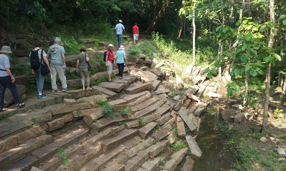Walking past a step-well ruin in the Ritigala Forest