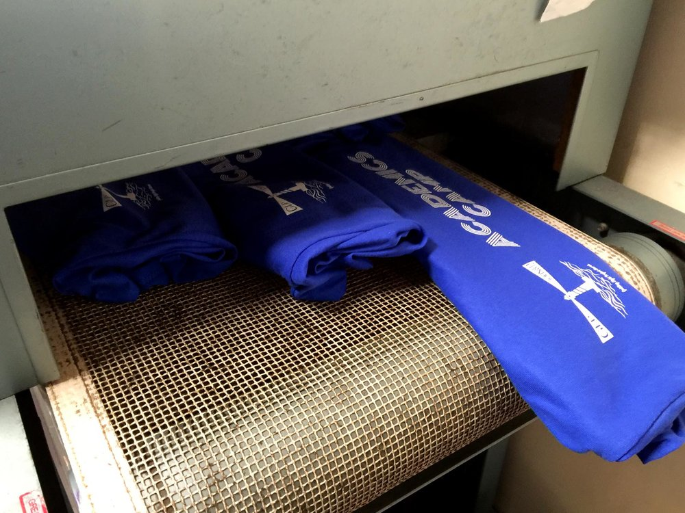 Running the shirts through the dryer.
