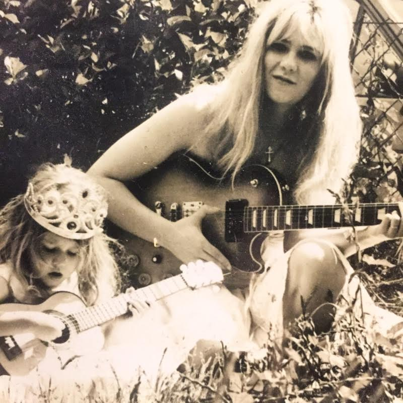 Image: Anneli age 3 and her mum age 23 both playing guitars