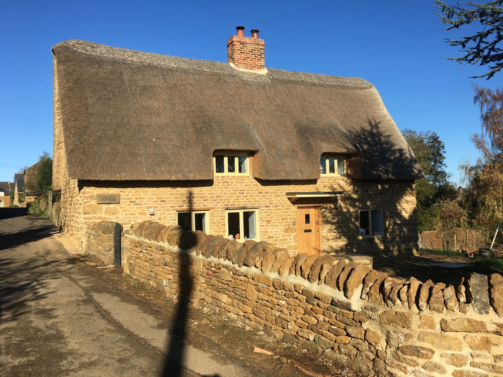 The Old Cottage restored, the existing masonry was saved and a new roof added