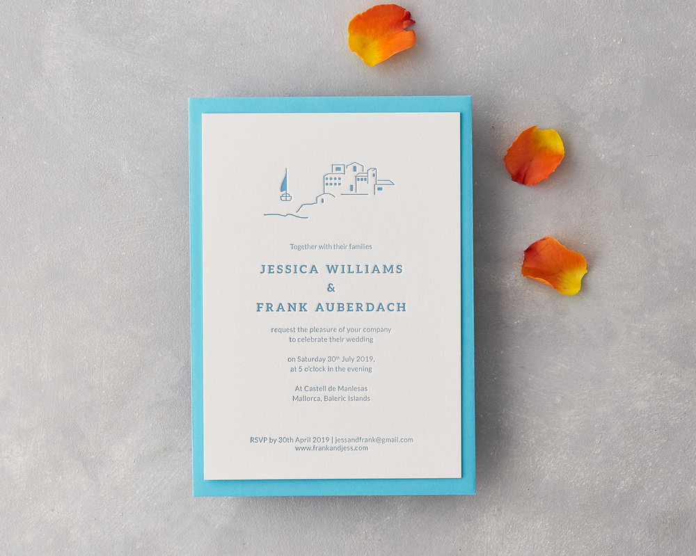 ISLAND INVITATION SITTING ON BLUE ENVELOPE