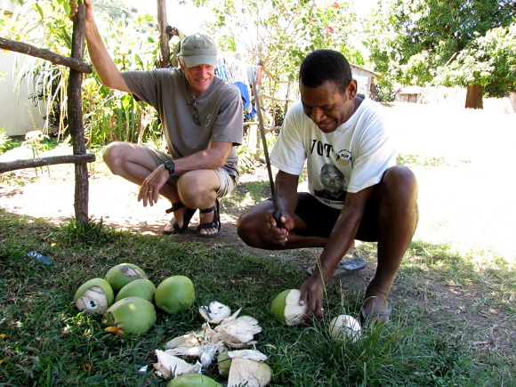 david shelling coconuts in vanuatu