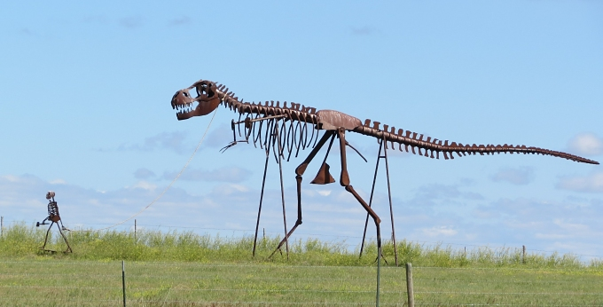 murdo skeleton man walking a skeleton dinosaur, south dakota