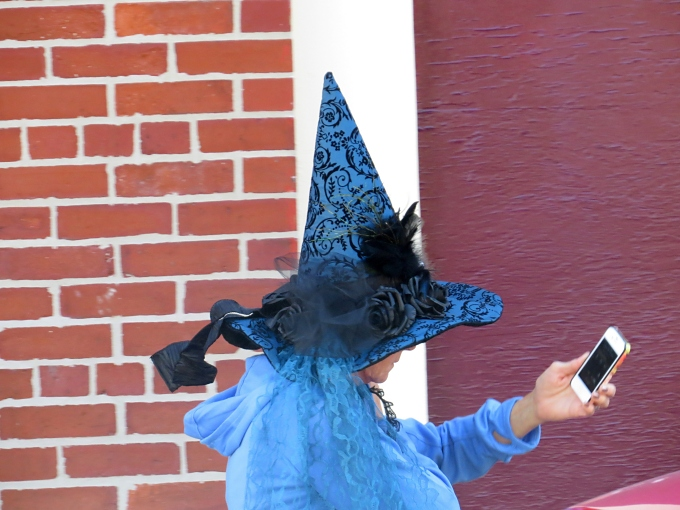 witch with her iphone