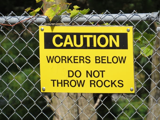 workers below do not throw rocks