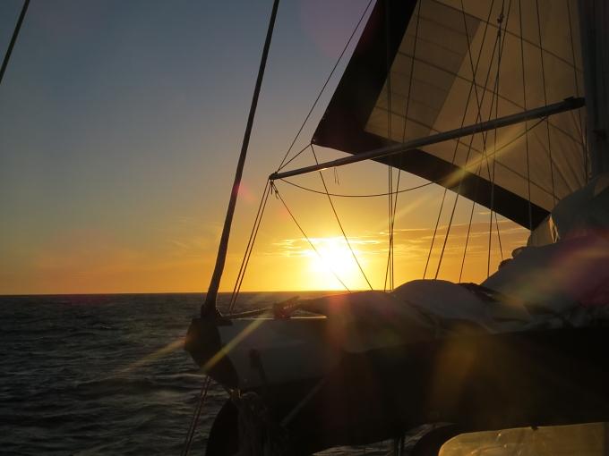 sunset through sails