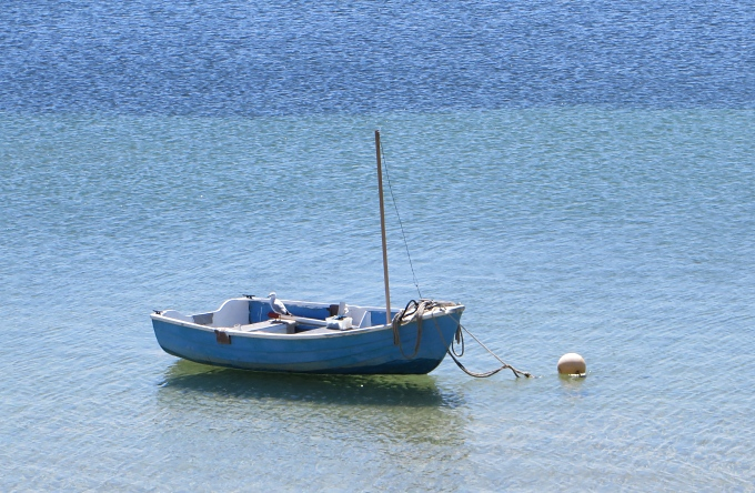lone blue dinghy