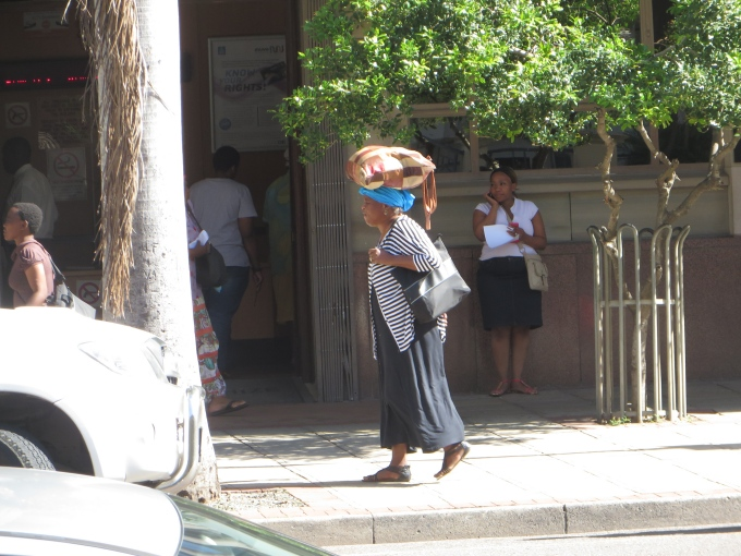 woman carrying bundle on her head durban south africa