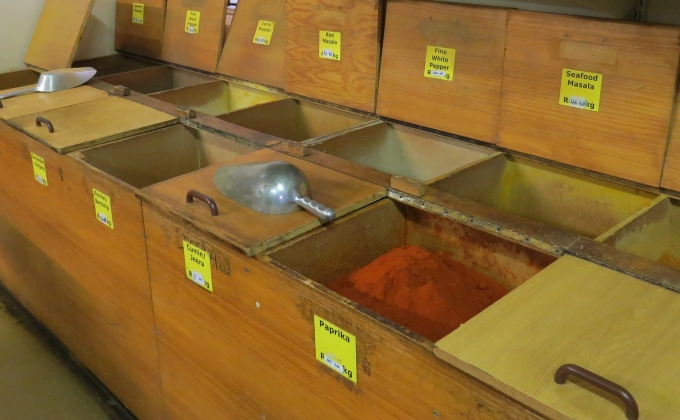 wooden bins full of spices at atlas trading company bo kaap