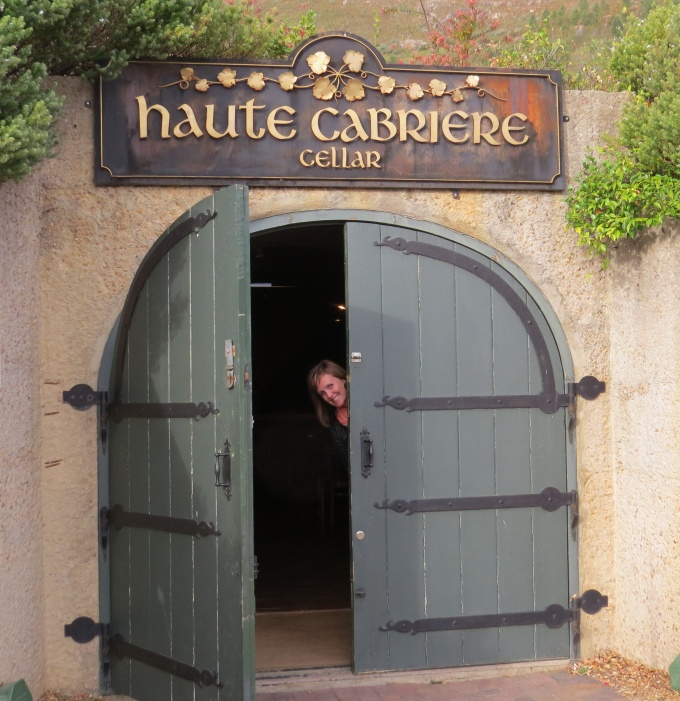 belinda peeks from haute cabriere door