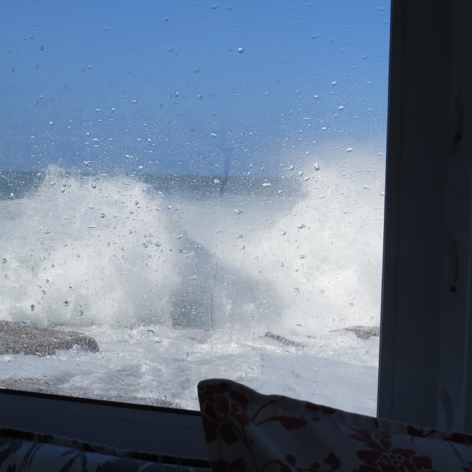 waves smashes into window
