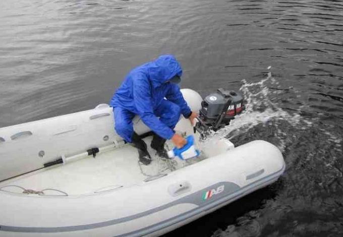bailing the dinghy with old laundry soap container