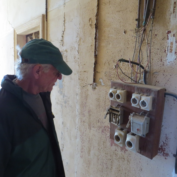 david checks an old fuse box kolmanskop namibia