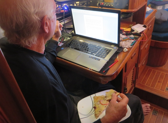 computer and cold pizza