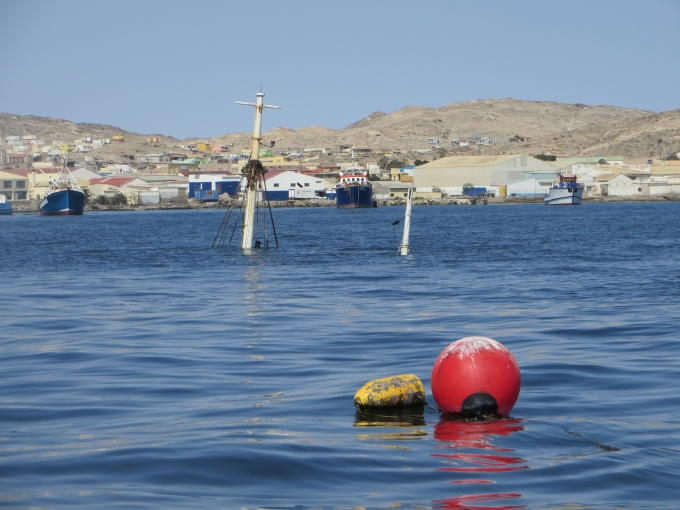 sunken boat by mooring