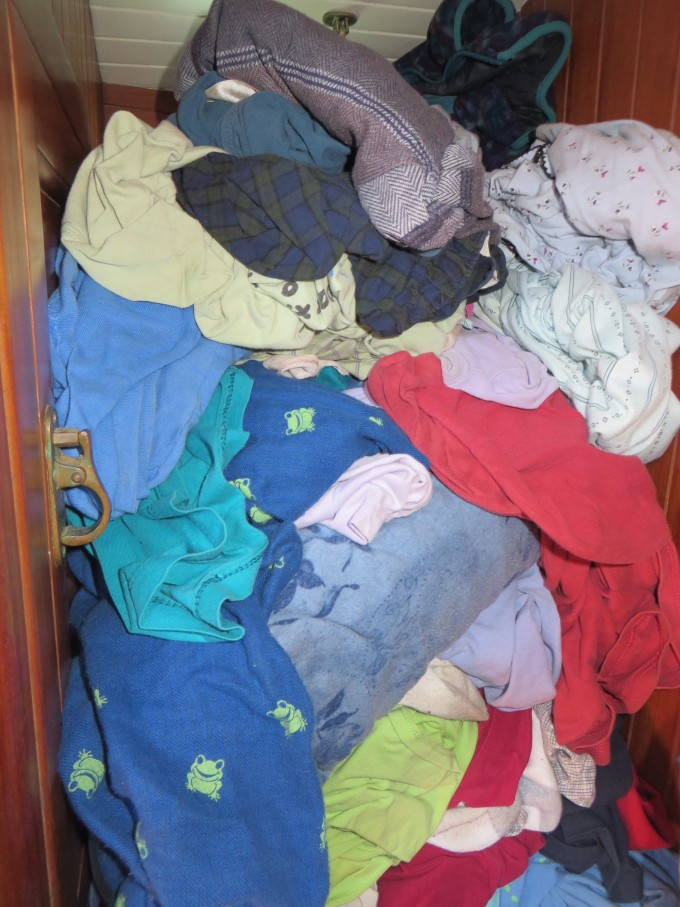a pile of laundry on nine of cups