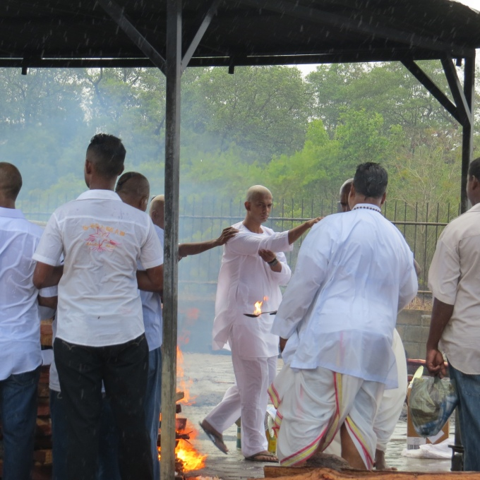 lighting the fire at a hindu cremation in suriname