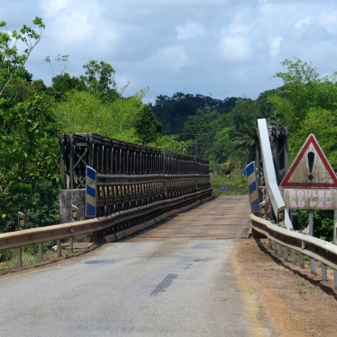 narrow plank bridge in french guiana