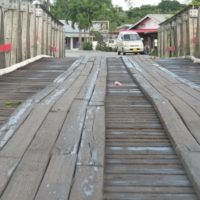 wooden plank bridge in suriname
