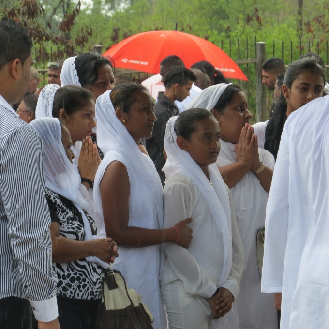 people in white at a hindu cremation in suriname