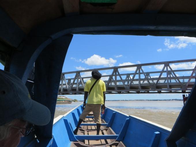 approaching the bridge in a pirogue