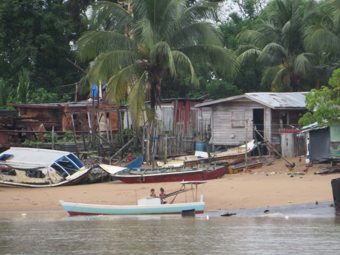 kids on the shore of the essequibo river