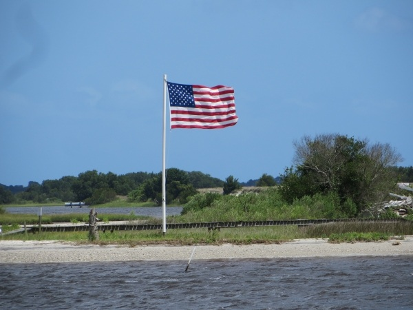 wind blown flag on the intracoastal waterway