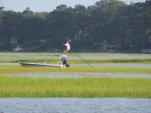 poling a john boat on the intracoastal waterway