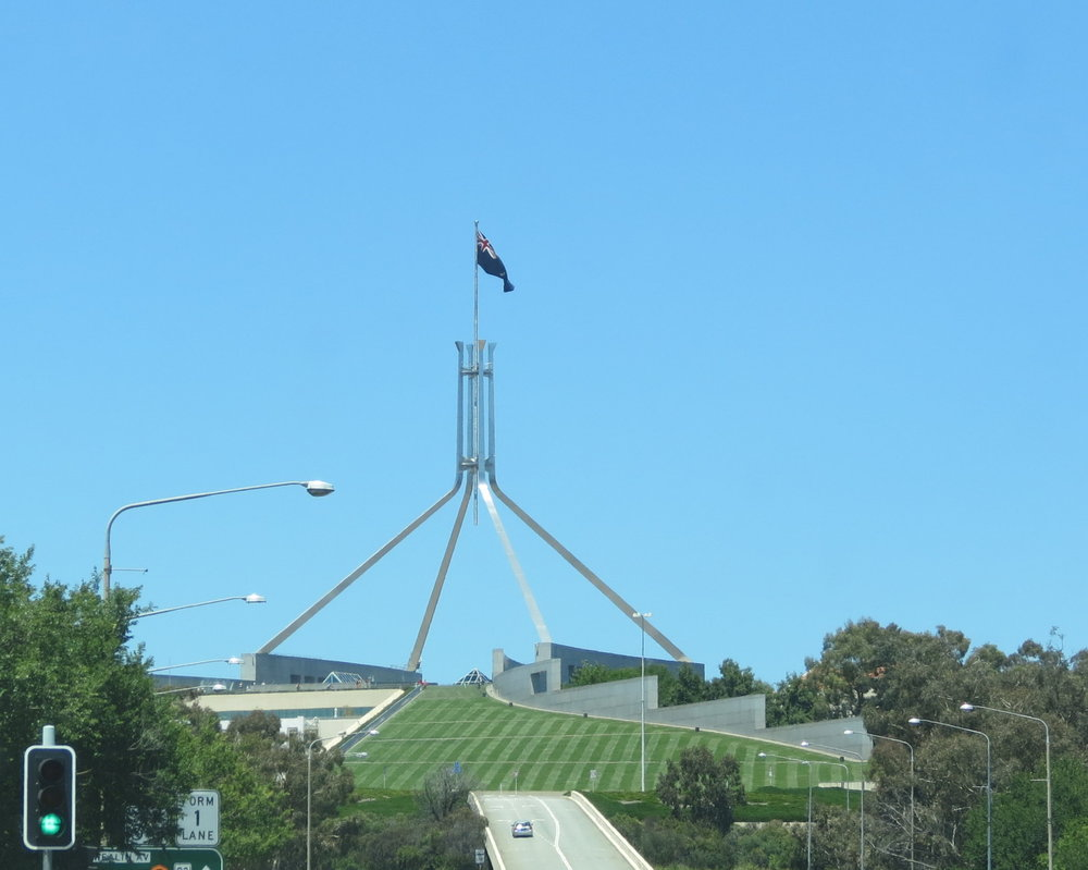 canberra flag flying over the capitol